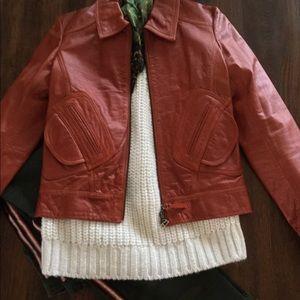 Waxed leather burnt orange Doma jacket.
